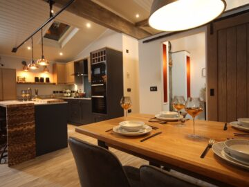 Maes Mynan North Wales Rustica Lodge - view across dining to kitchen - Aspire Park & Leisure Homes